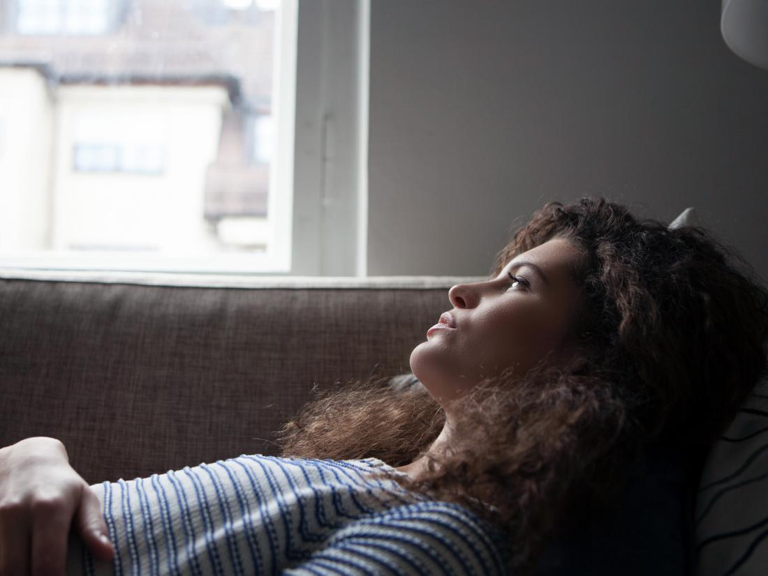 a woman lying down experiencing the Effects of hepatitis C