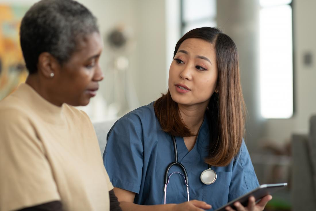 a doctor sharing results with an elderly patient<!--mce:protected %0A-->