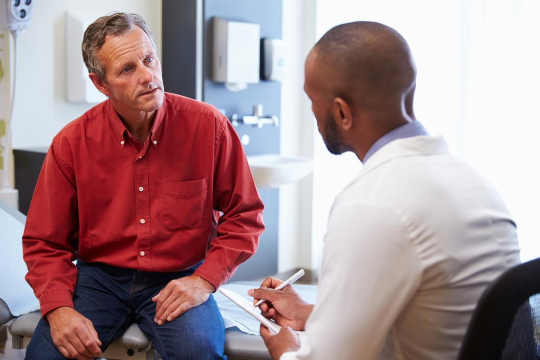 man discussing chronic prostatitis with male doctor in office