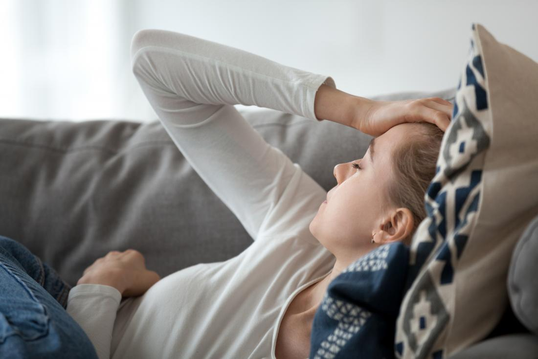 a woman experiencing fatigue from hyperinsulinemia