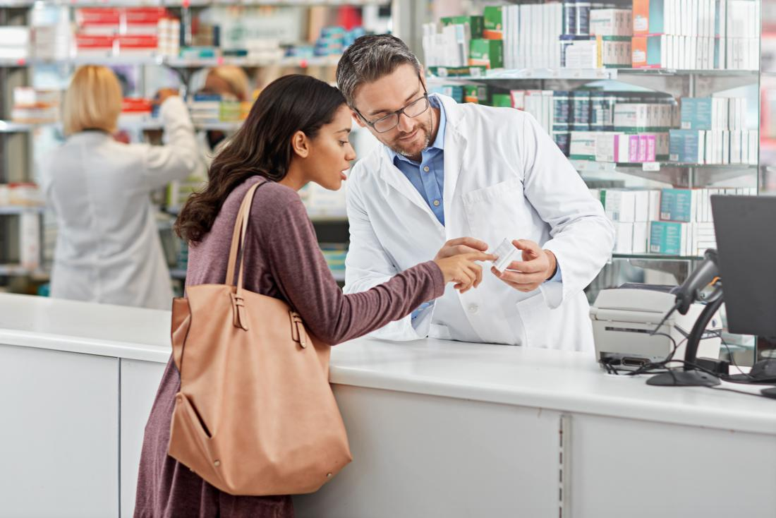 a woman picking up beta blockers at a pharmacy for her anxiety