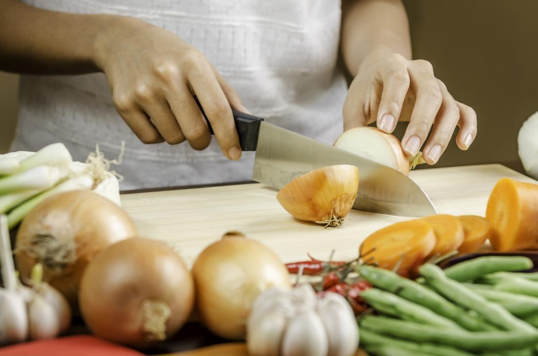woman chopping onion