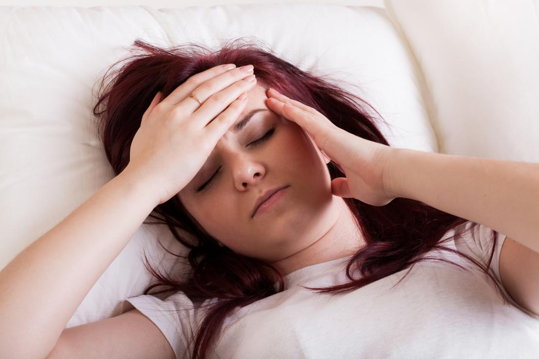 a person may experience a low grade fever and headaches after a tonsillectomy