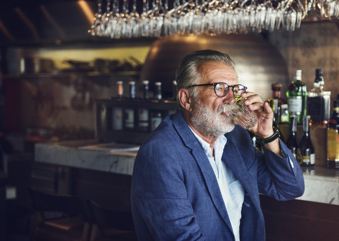 Older adult drinking in bar