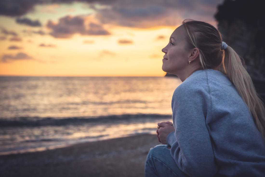 a teenage girl with cystic fibrosis looking out to sea and wondering what her life expectancy is