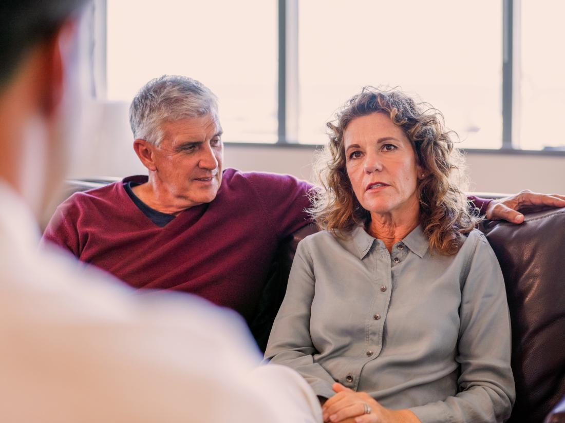 a man and woman talking to a couples therapist
