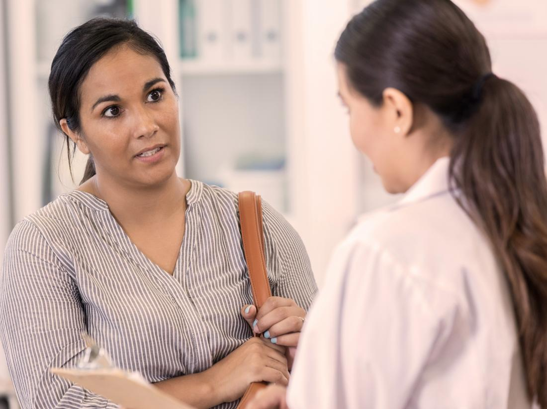 a doctor and a female patient having a discussion.