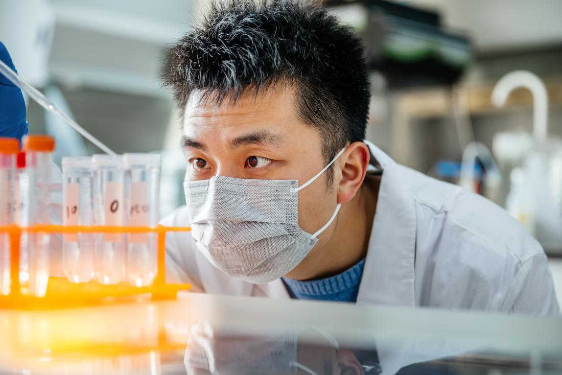 researcher handling pipette in the lab
