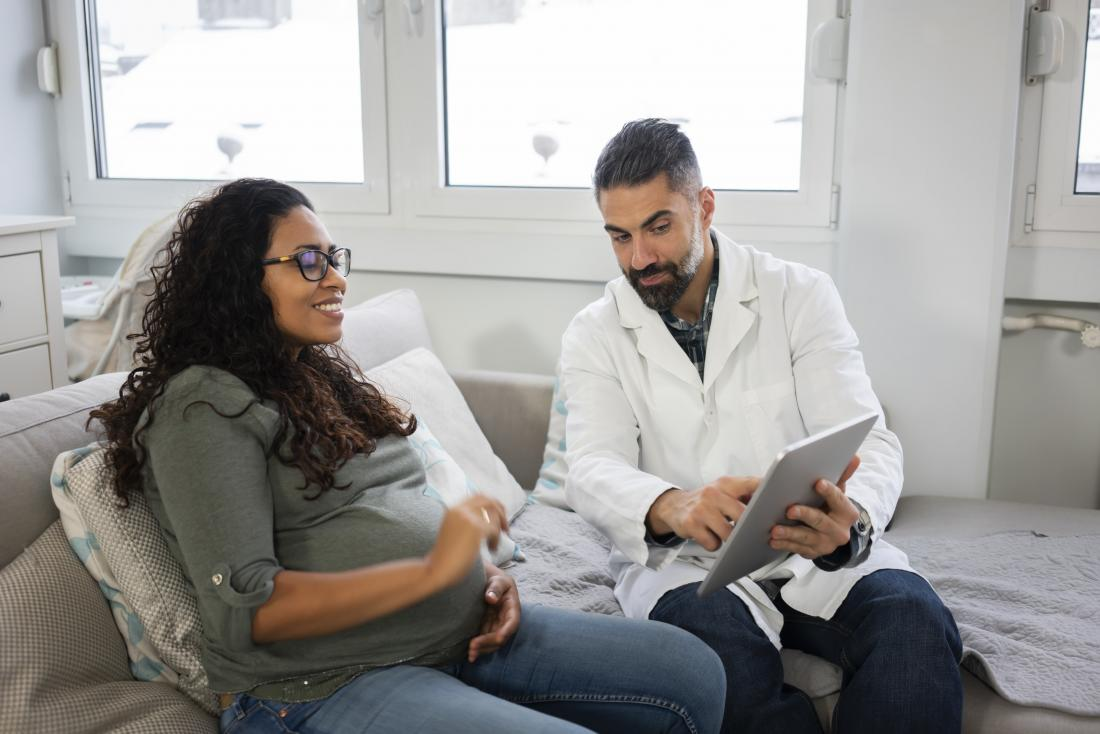 a pregnant woman having a final check with a doctor.