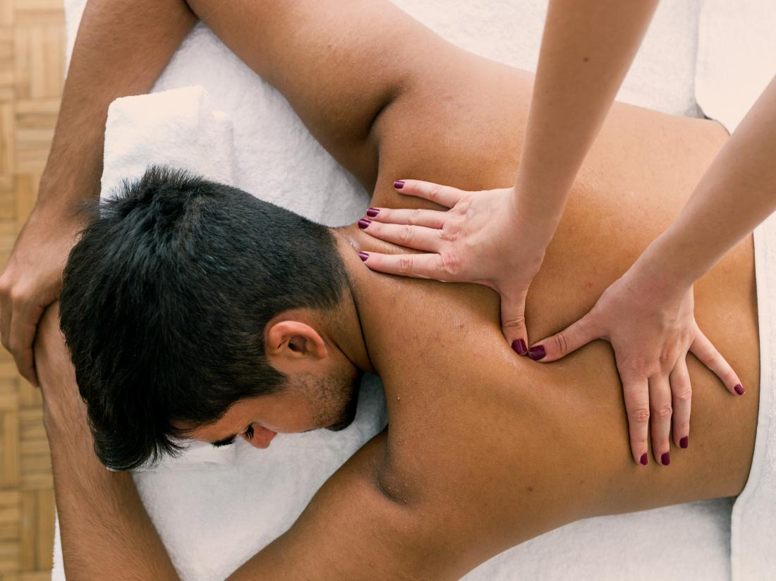 a man getting his upper back massaged