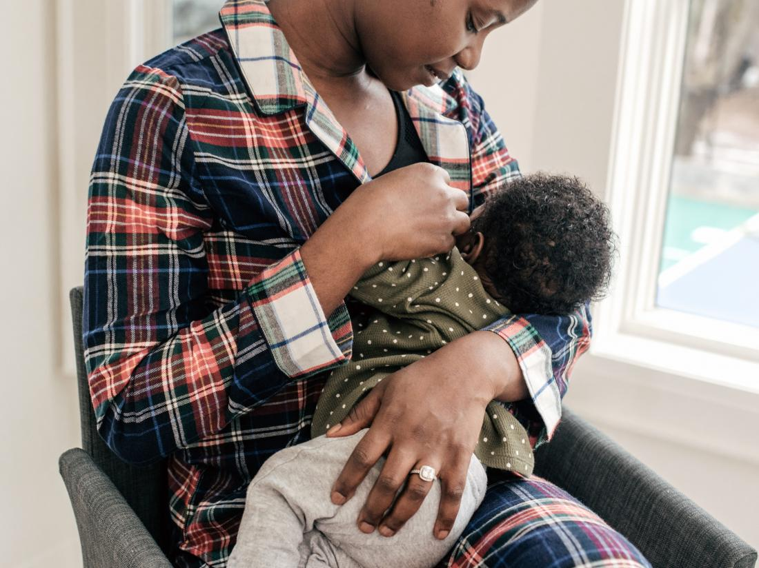 a woman achieving postpartum weight loss by breastfeeding.