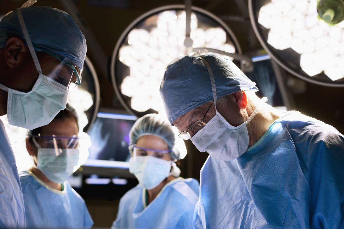 surgeons in operating theatre performing crohn s surgery