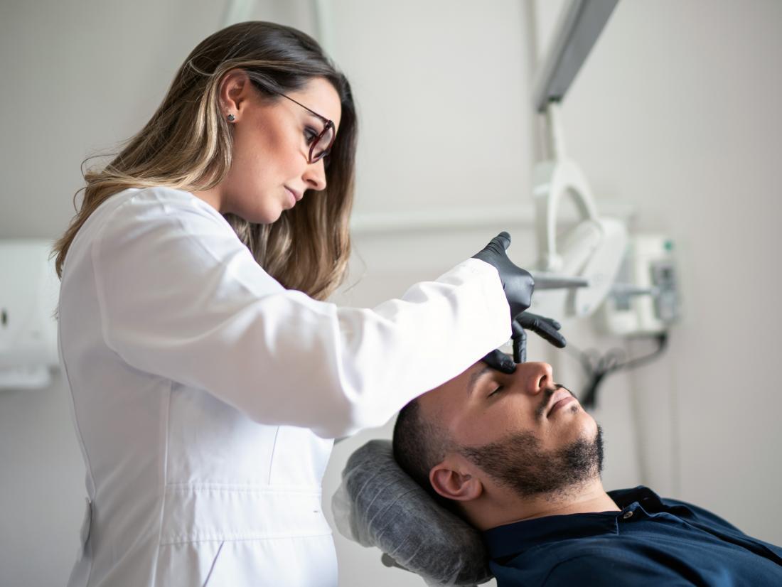a man receiving botox to his face.