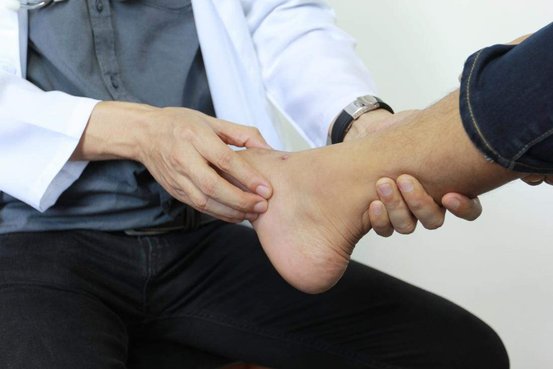 a doctor examines a foot