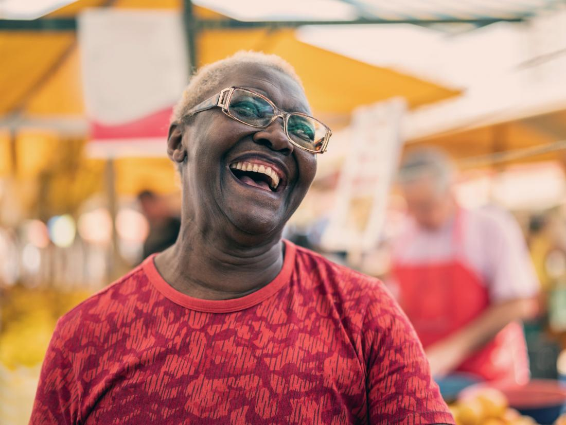 a laughing senior black woman.