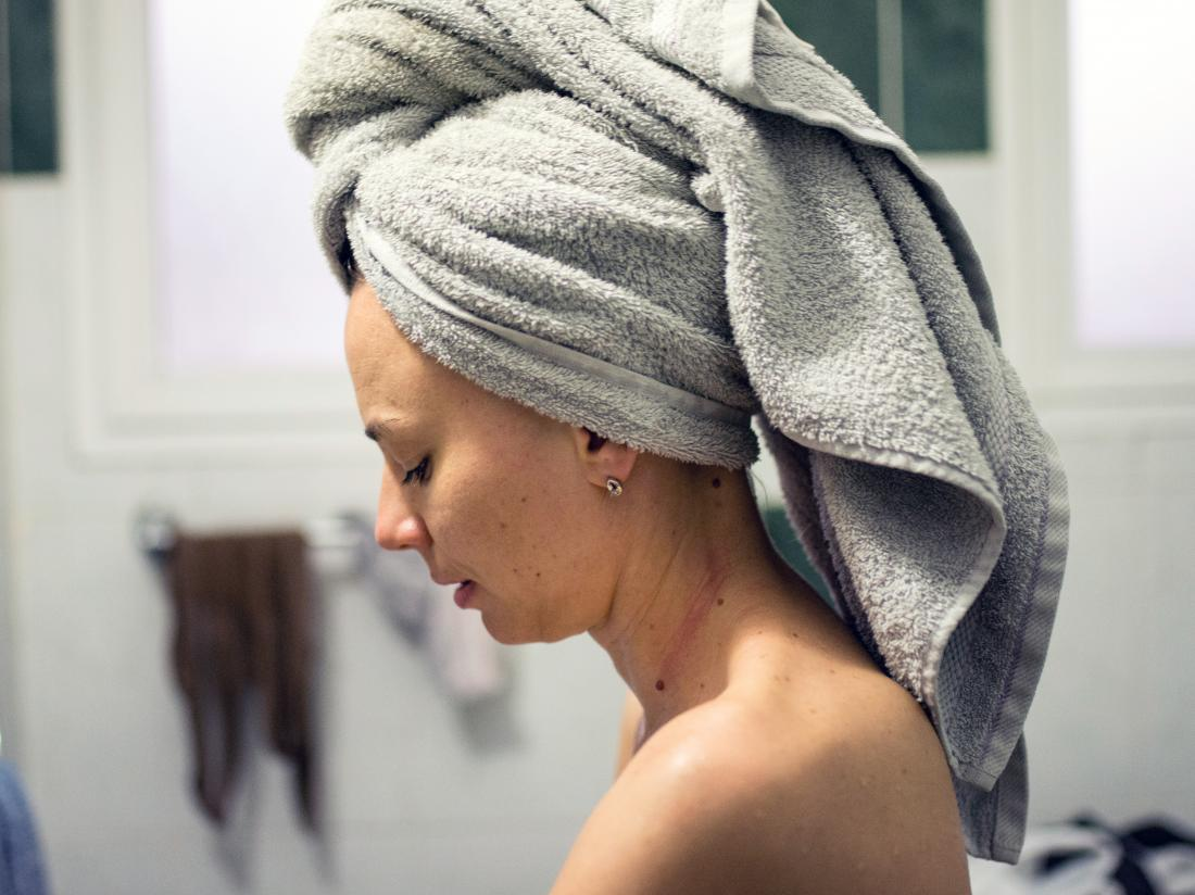 a woman with a towel on her head who can't can't feel her IUD strings
