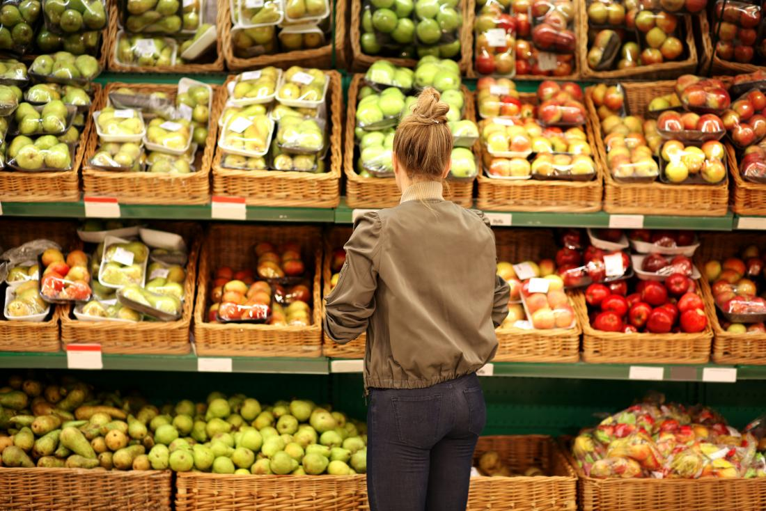 a woman shopping for fruit