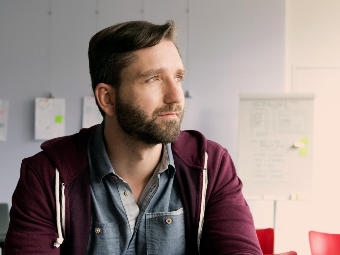 a man looking pensive as he may have metastatic prostate cancer