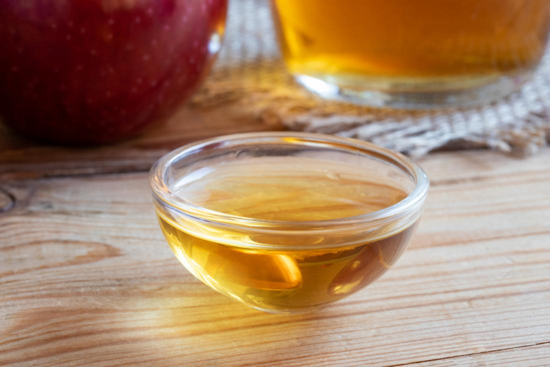 apple cider vinegar in small glass