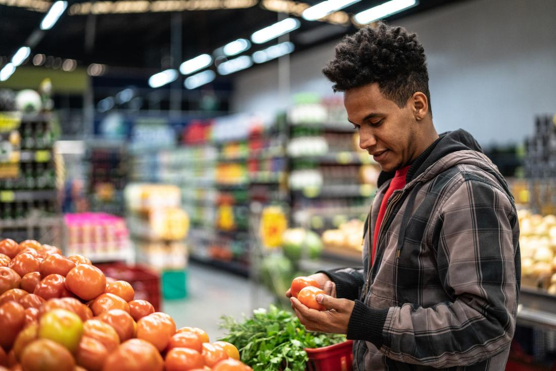 young man grocery shopping<!--mce:protected %0A-->