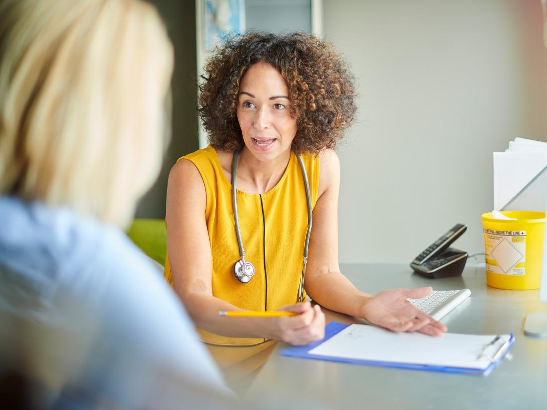 a doctor explaining to a patient what her gleason score is