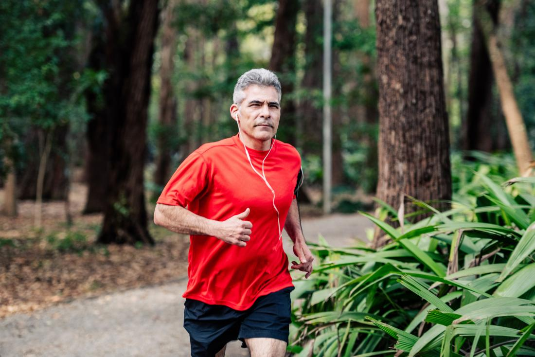 a man jogging in the woods<!--mce:protected %0A-->