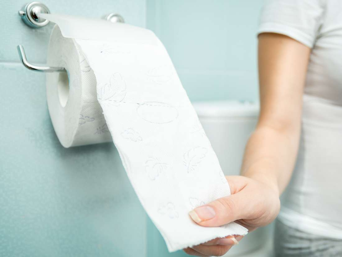 White specks in stool: Causes, treatment, and tips